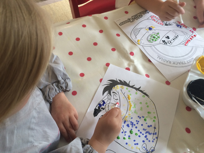Concentrating on doing their dots
