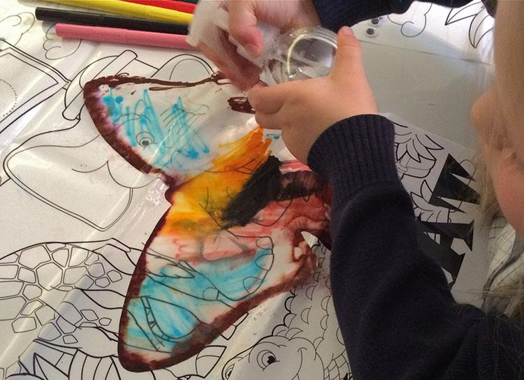 YC enjoying spraying her butterfly.