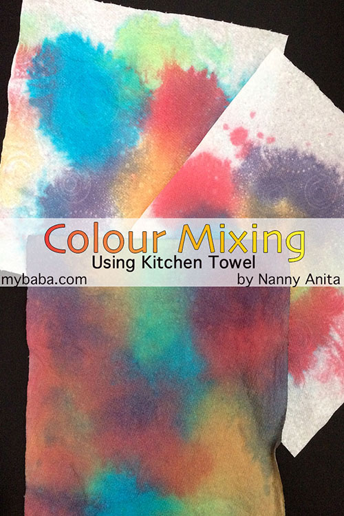 Exploring colour mixing using kitchen towels.