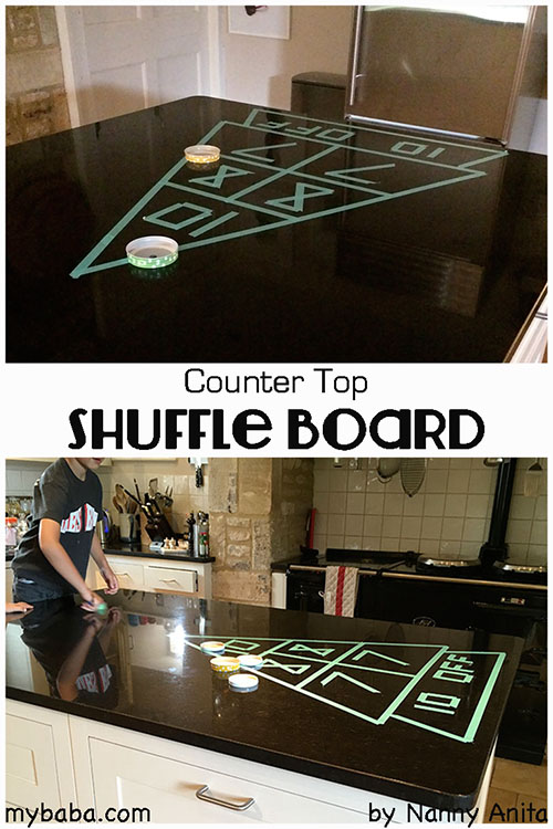 DIY shuffleboard made using washi tape on the work surface. A great game for coordination and maths.