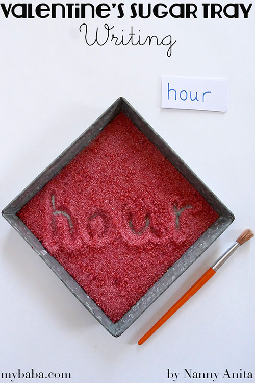 A valentine's themed sugar writing tray to practice spellings in. Great for kinaesthetic learners.