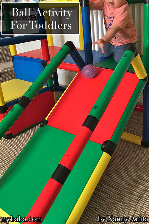 You don't need fancy things to do this, just a slide and some balls. Toddler activity for gross motor skills.