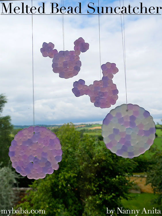 Melted bead sun catchers made using uv colour changing pony beads