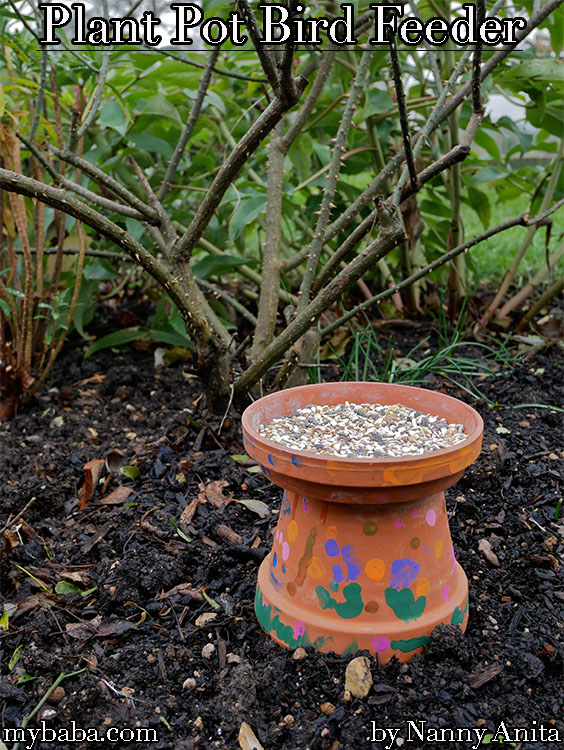 Upcycled plant pot bird feeder.  A fun activity for children to get involved with.