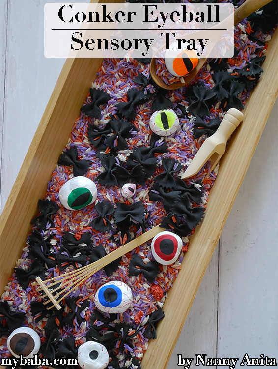 Halloween conker eyeball sensory tray for children.